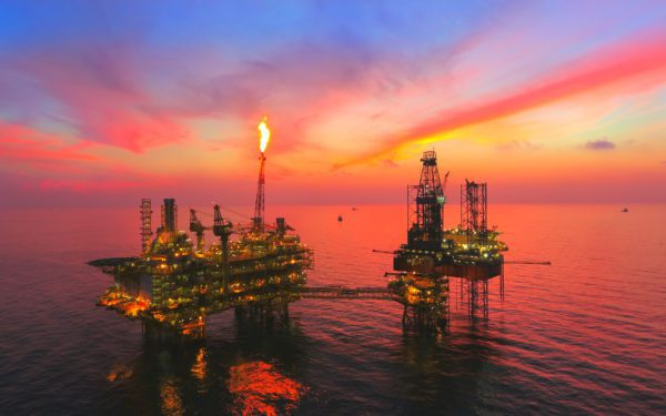 Oil,Rig,At,Late,Evening,(offshore),Areal,Photography,During,Sunset.